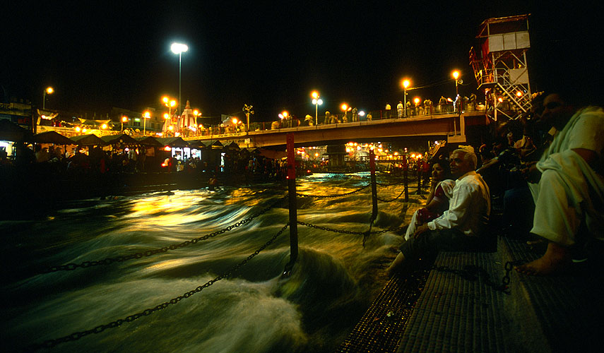 Pilgrims soak up the festive atmosphere on the banks of the Ganges during a mela festivalNikon F5, 17-35mm, Fuji Velvia 100