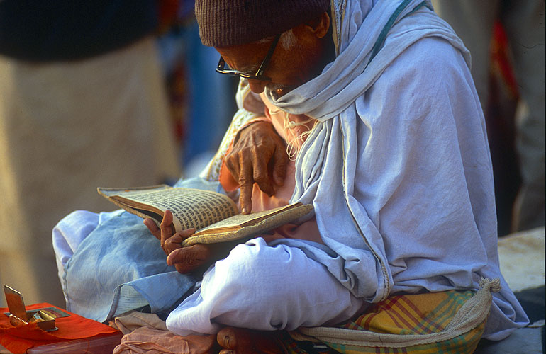 A Hindu reading his holy book on the banks of the GangesNikon F5, 180mm, Fuji Velvia 100