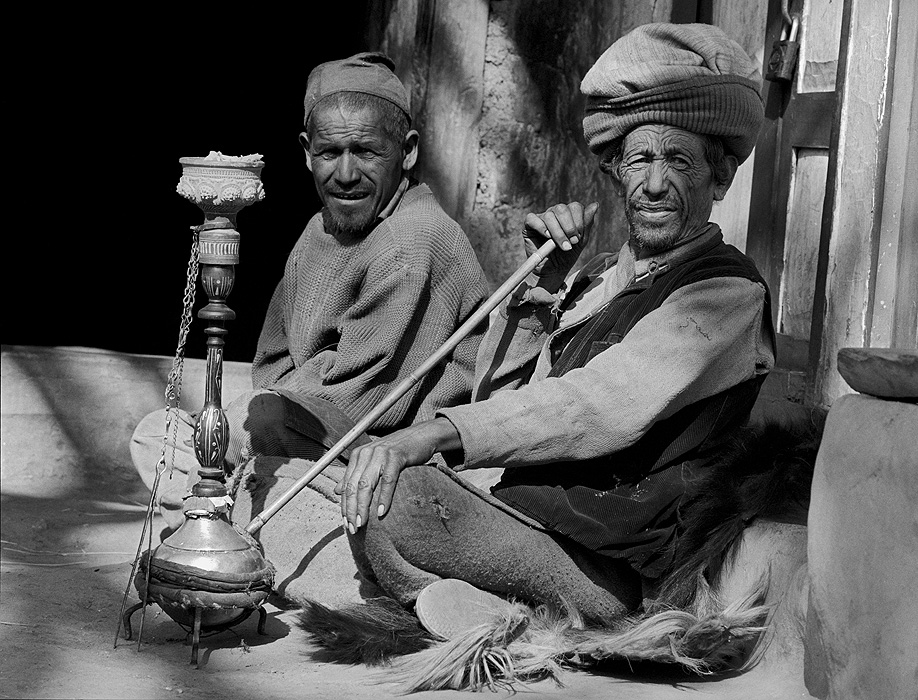 A dhami and his friend relaxing with a hookah in the sun at a chai-shop on the trail from Simikot to Kermi in the Humla Karnali valleyBronica ETRSi, 70mm, Ilford HP5 @ 800ASA