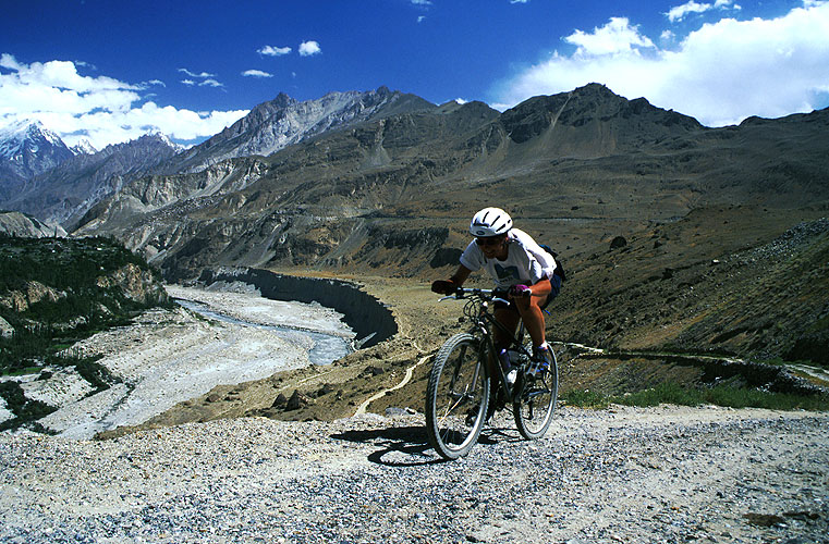Though the KKH has brought many changes and much progress to the Hunza valley with its Pak-China traffic,  many villages remain untouched. In places where the old track still exists, mountain bikers can find challenging rides and no trafficCanon EOS 500, 28-80mm, Fuji Velvia