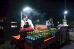 Lime soda stall on the banks of the Ganges at night.