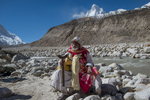 A sadhu just below the source of the Ganges / Bhagirathi at the snout of the Gangotri glacier. Shivling towers behind him.