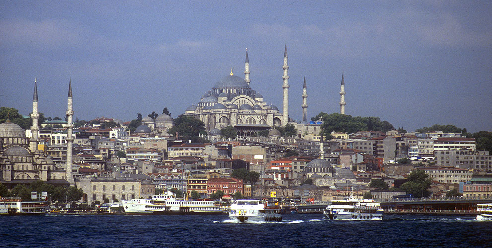 From a ferry on the Bosphorus, the Blue Mosque (Sultan Ahmed Mosque) dominates the skyline of the fabulous city of Istanbul. Completed in 1616, the historical context can be set by remembering that the nearby Hagia Sophia was already almost a thousand years old at that time!Nikon F5, Fuji Velvia, 17 - 35mm