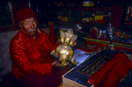 Samyjor Lama, the Abbot of Jhang Gompah, displays a priceless relic saved from the destruction of the Cultural Revolution by villagers at Tholing in neighbouring Tibet. This and several other similarly precious sacred items were then spirited across the border into Limi, where they have been safely kept ever since. This partially broken figure is at least a thousand years old and gives us an inkling of the fabulous cultural wealth that once was part of the Kingdom of Guge.North-west Nepal.Nikon FM2, 17-35mm, Fuji Velvia 100