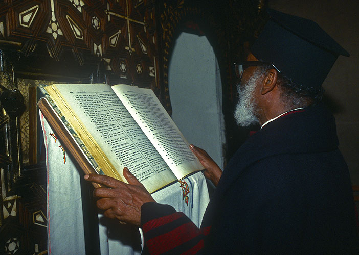 The Assistant to the Archebishop of the Ethiopian Orthodox church in Jerusalem reads the service on Easter Sunday nightNikon F5, Fuji Velvia 100, 17-35mm