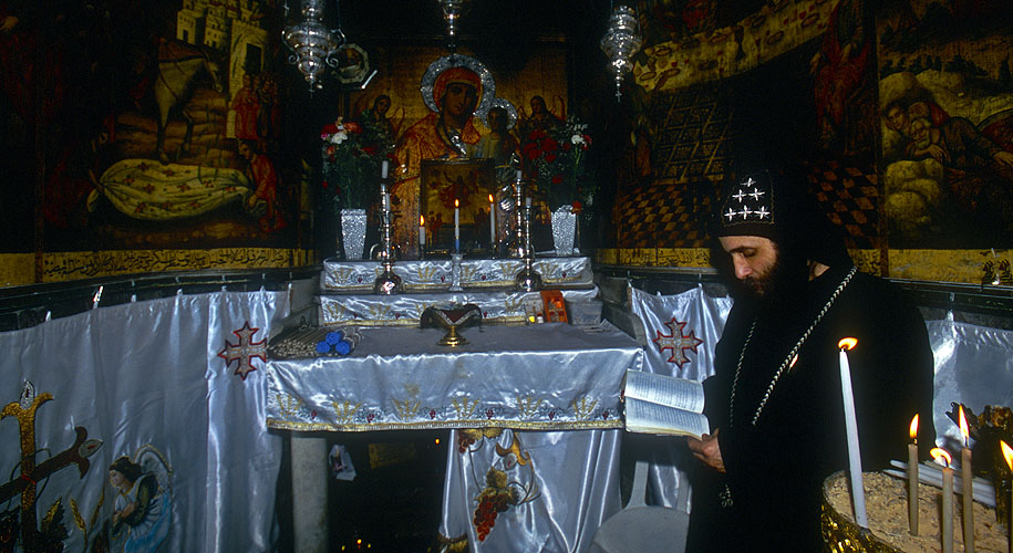 An orthodox priest  in the Church of the Anastasis, JerusalemNikon F5, 17-35mm, Fuji Velvia 100