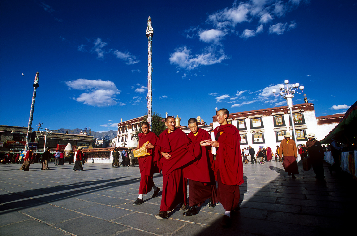 Buddhist monks taking an afternoon stroll in the huge plaza in front of the Jokhang.Nikon F5, 17mm, Fuji Velvia