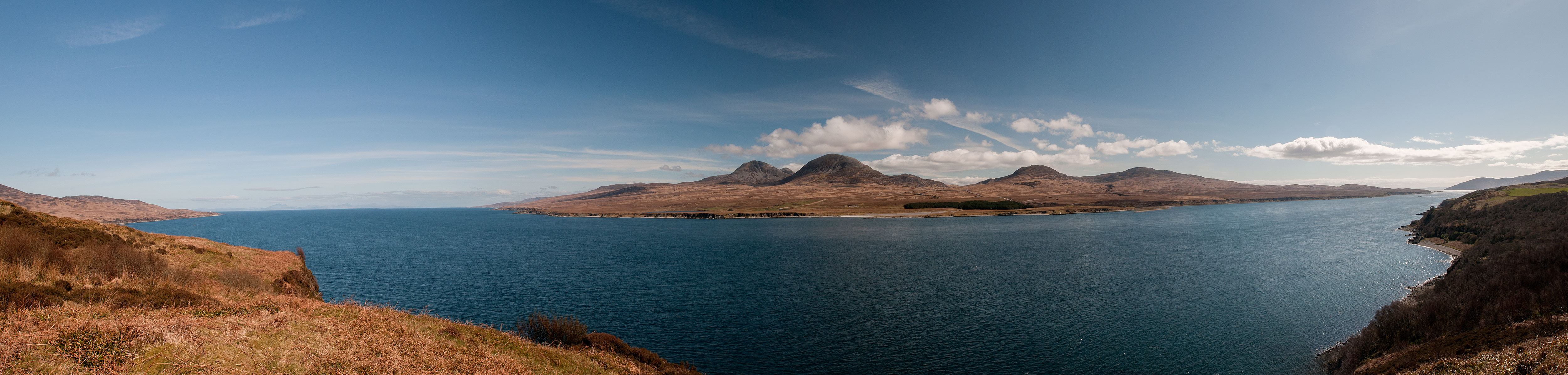 A view north and east from above Port Askaig on the adjacent Isle of Islay. The Paps of Jura are clearly visible. This is a stitch of seven images.Nikon D610, 17-35mm