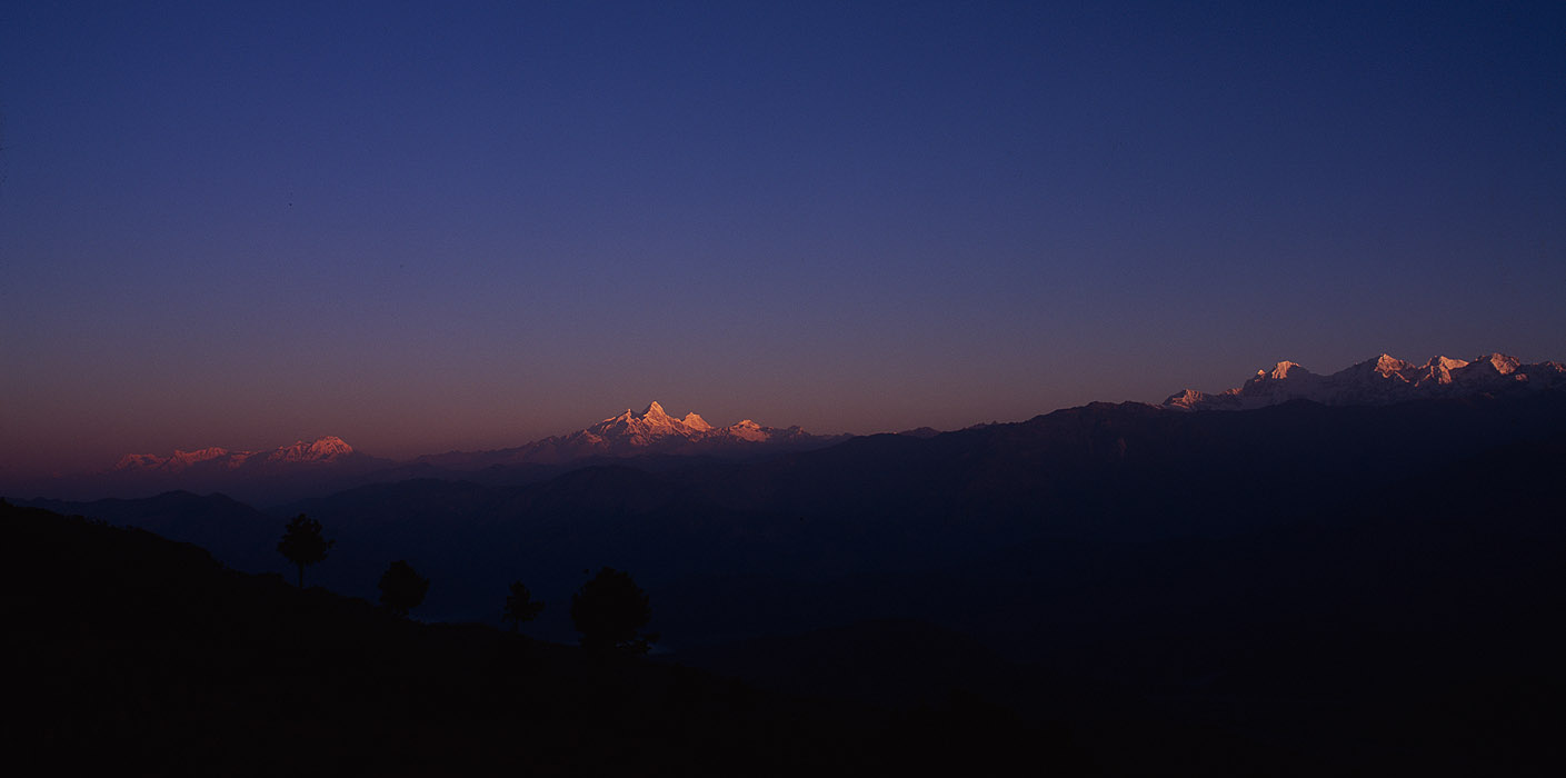A sunrise panorama from the Kathmandu valley rim, looking weat to Langtang, Manaslu and AnnapurnaProject VeronicaMedium format images re-scanned in a professional glass film- holder with my Nikon Coolscan 9000 and Silverfast 8 software. These images display larger on the site - enjoy!Bronica ETRSi, 50mm, Fuji Velvia