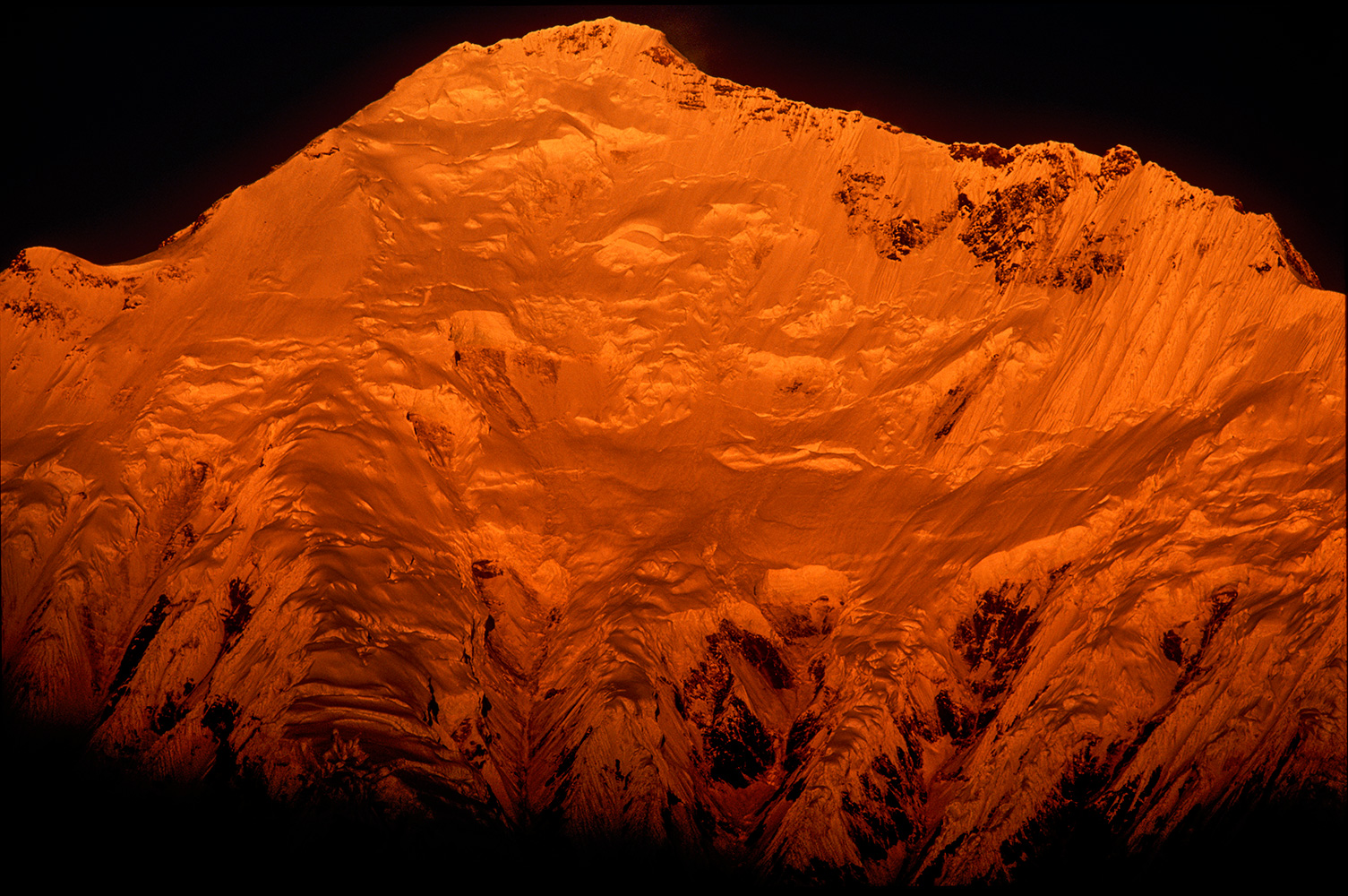 Sunrise on the Kangshung Face, from Pethang Ringmo (4983m) on the Kangshung Glacier.Nikon F5, 180mm, Fuji Velvia 100