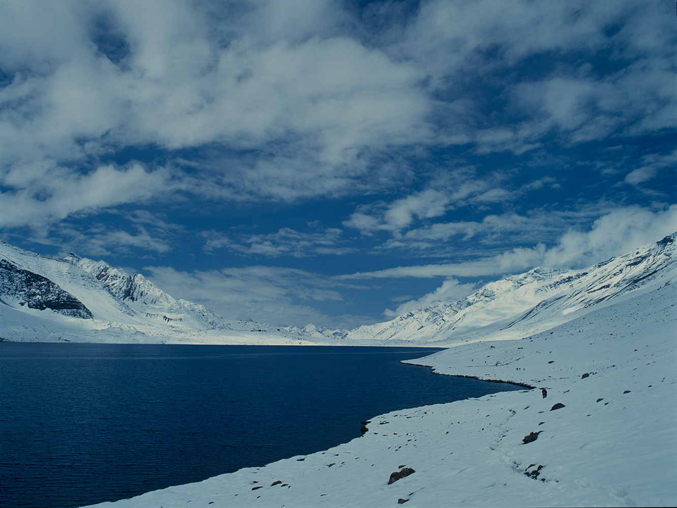 This lake lies on the Karumbar Pass, between Chitral and Ishkoman in the most remote corner of Pakistan's mountainous north. It is just a few kilometres from Afghanistan. Seen here after a summer snowstorm in the month of July.Bronica ETRSi, Fuji Velvia