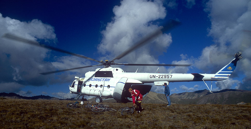 Unloading mountain bikes from an ex-military Mi8 helicopter atop a mountain in Kyrghyzstan. This is followed by several hours of downhill mayhem...Nikon FM2, 24mm, Fuji Velvia