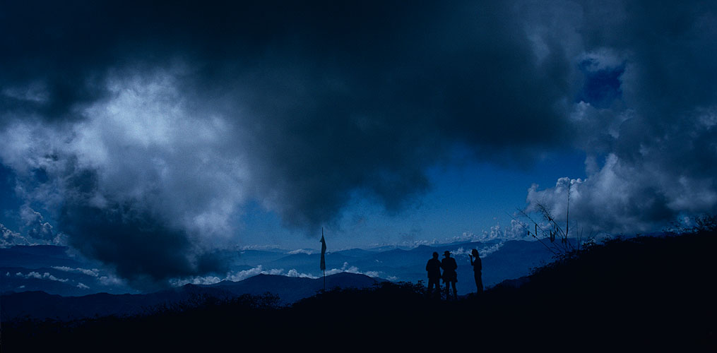 Rex {quote}Rexatious{quote} Munro again, with our porters on reaching the first col of the Shipton Pass during our 1988 trip, with the moisture laden air from the Arun Valley bringing a constant flow of cloud up behind himCanon A1, 28mm, Kodachrome 64