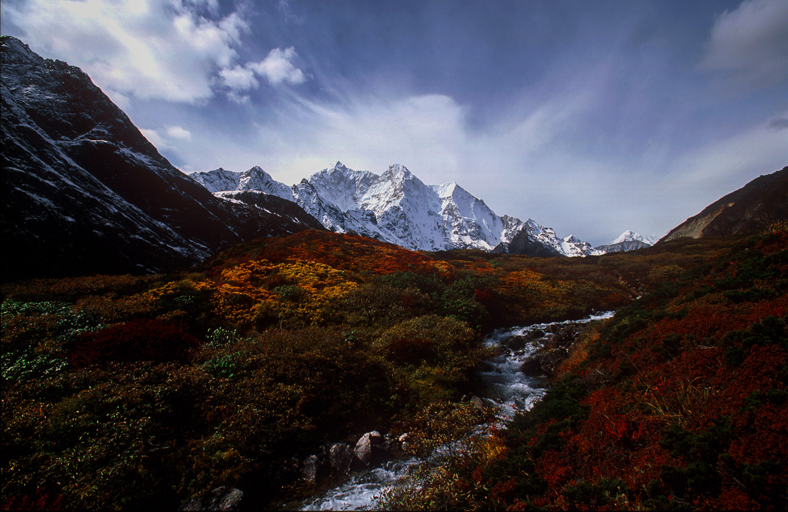 Beneath the towering north face of Chomolonzo (7677m), the incomparable Kharta Valley drains the eastern (Kangshung) face of Everest.Nikon F5, 17mm, Fuji Velvia 100