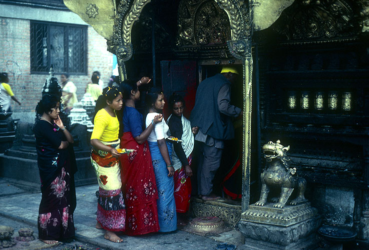 Queuing to make puja at a tiny shrine in Durbar SquareNikon FM2, 24mm, Fuji Velvia
