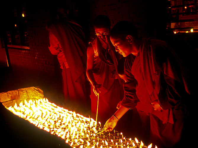Monks lighting butter lamps during the festival of LhosarNikon F5, 17-35mm, Fuji Provia 400