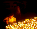 A boy lighting butter lamps during the festival of LhosarNikon F5, 17-35mm, Fuji Provia 400