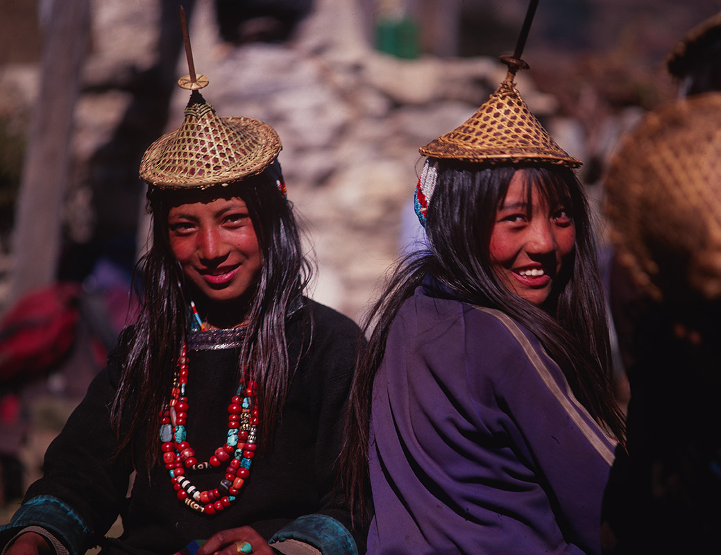 Laya women are unique in Bhutan in that they wear their hair long. They also wear distinctive dress made of yake hair and sheeps wool, topped with a conical bamboo hat. These hats are associated with fertility.Bronica ETRSi, 75mm, Fuji Velvia