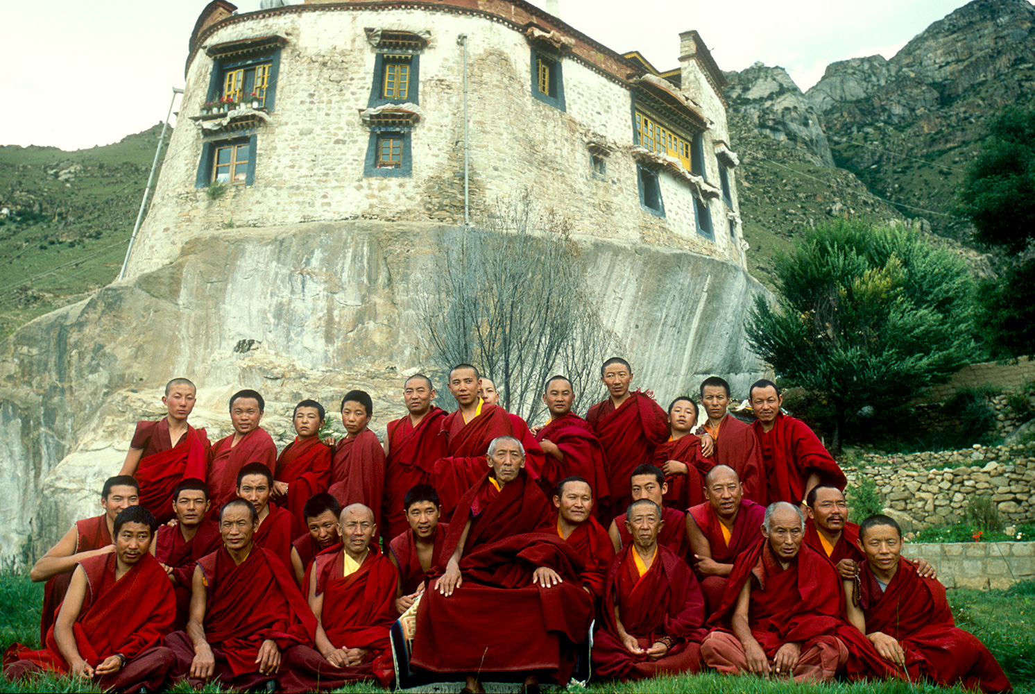 The Abbott poses for a photograph with a group of monks who have just completed a year's retreat at this beautiful monastery in a high valley near Lhasa.Nikon F5, 17mm, Fuji Velvia