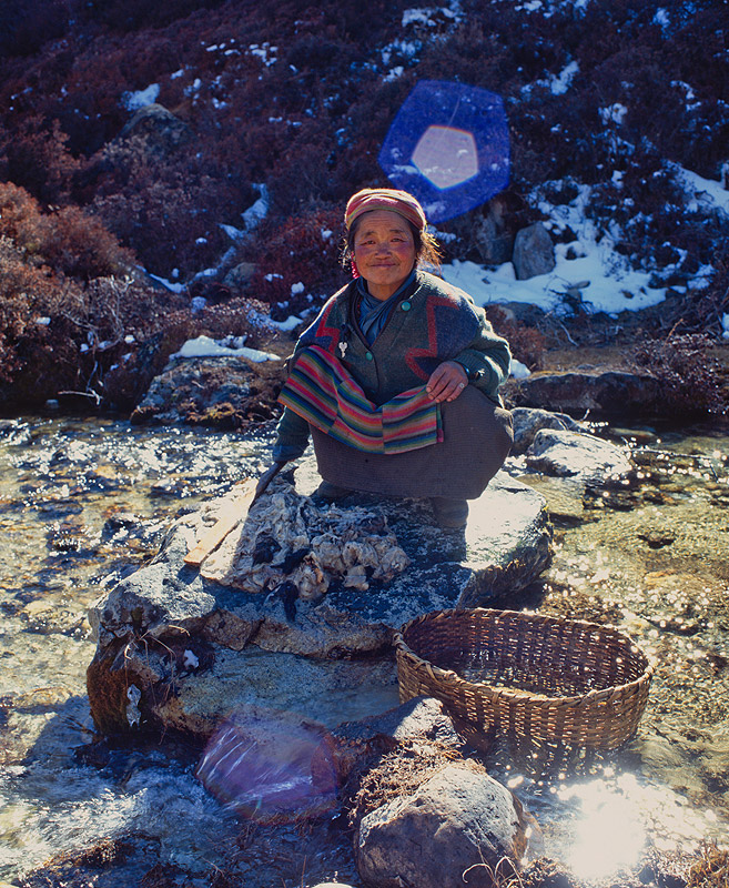 A womoan from Ghunsa prepares yak-wool for spinning at Lhonak on the Kangchendzonga glacierProject VeronicaMedium format images re-scanned in a professional glass film- holder with my Nikon Coolscan 9000 and Silverfast 8 software. These images display larger on the site - enjoy!Bronica ETRSi, 50mm, Fuji RDP2