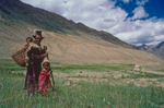 A man and his children in the fieldsCanon A1, 28mm, Kodachrome