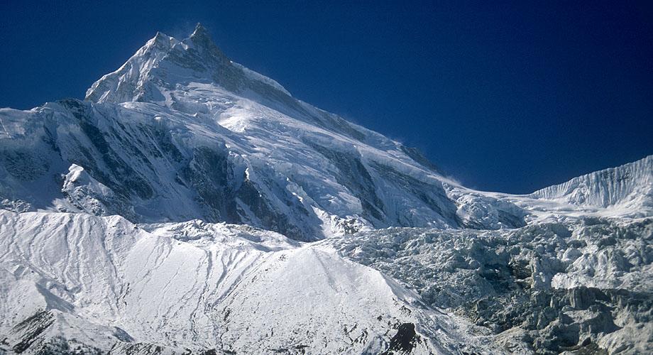 Manaslu (left) and Manaslu North, towering over the Manaslu glacier, from a ridge above Sama Gaon in the upper Buri Gandaki valley.Canon EOS 500, 80mm, Fuji Velvia