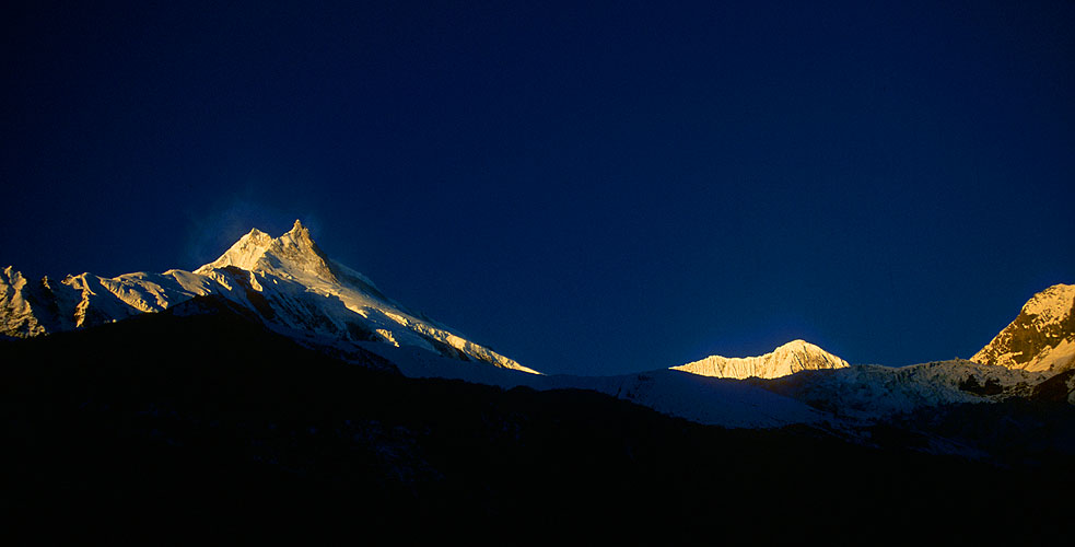 Sunset light on Manaslu (8150m) and Manaslu North from a ridge above Sama Gompah.anon EOS 500, 28mm, Fuji Velvia