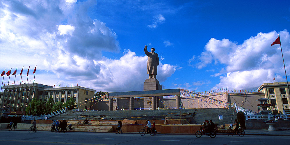 The Chairman stands over the plaza that was created in his honour. Sadly much of the city's historic Uigar architecture has been bulldozed to make way for the mundanities  of modern Chinese power.Nikon FM2, 24mm, Fuji Velvia