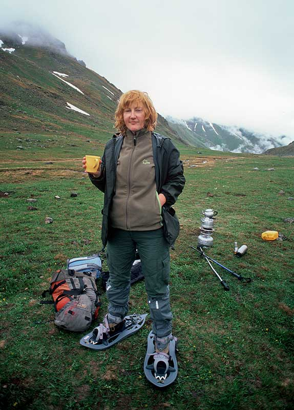 Trying on her snow shoes at Dupeduzu (2700m) ready for a crossing of the Neletleme Pass