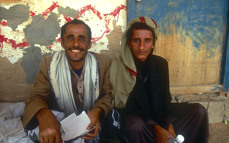 Two Bedouin men at a roadside qat-stopNikon F5, 17-35mm, Fuji Velvia 100