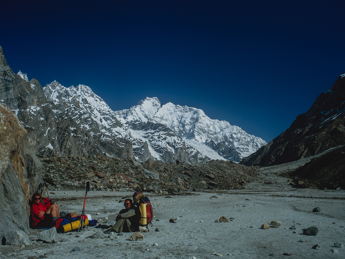 From the summer grazing ground between Saitcho and Dalsan on the Gondokoro glacier above Hushe. Mark Miller and Anwar Ali resting en route to Gondoro Peak BC.