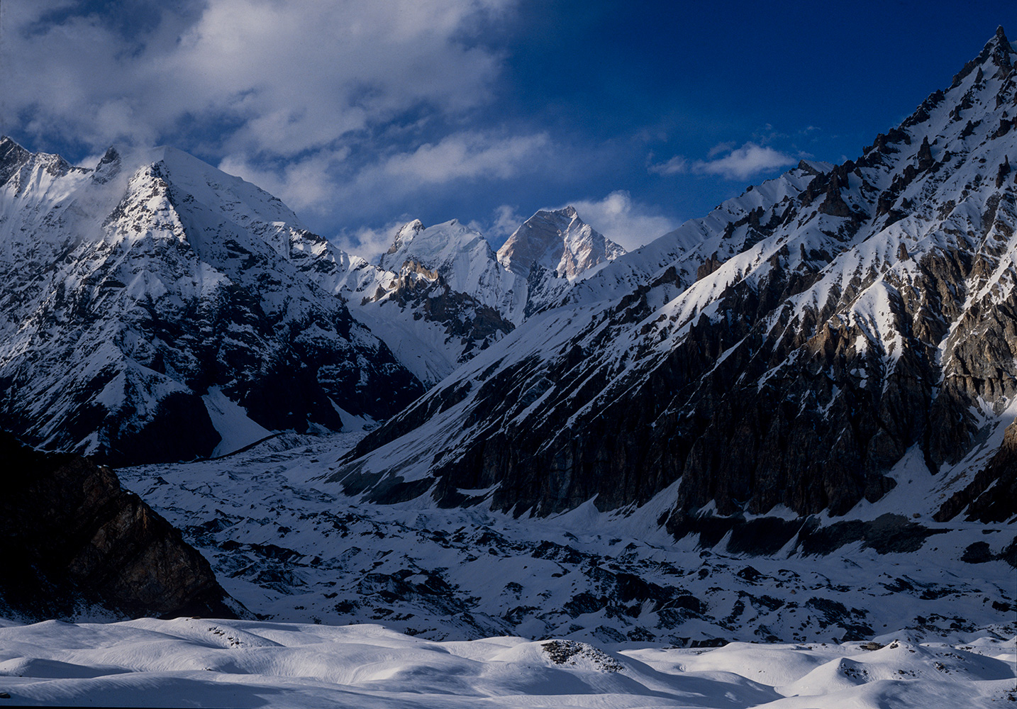 This rarely seen aspect of the mountain is tantalisingly visible from a high camp on the upper Aling glacier