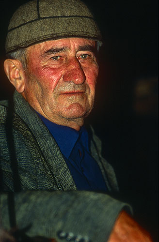 Islam Pilpani,  leader and conductor of a group of men in this village who have dedicated themselves to learning and keeping alive the ancient tradition of polyphonic singing.  Svaneti's traditions are perhaps the oldest and most traditional in Georgia due to the region's isolation. Svan harmonies are irregular and angular, and the middle voice leads the supporting vocals, all within a narrow range.Nikon F5, 17-35mm, Fuji Velvia 100