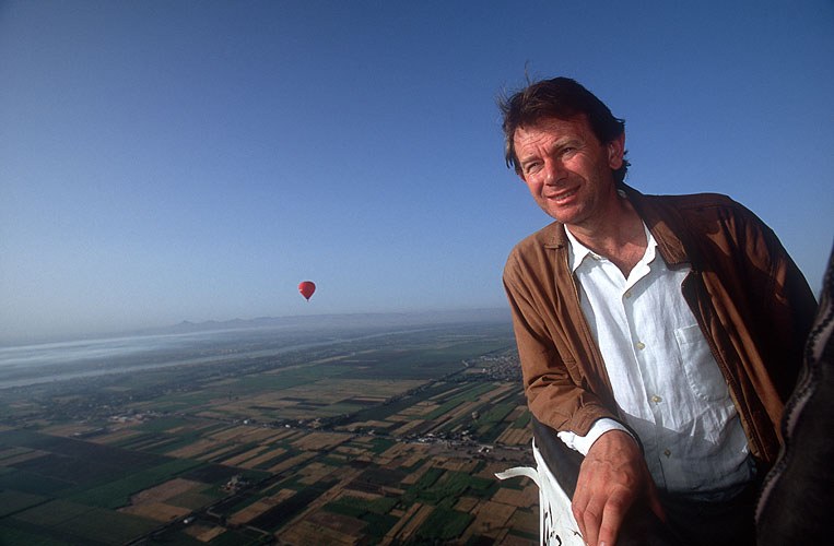 The presenter of {quote}In Search of Myths and Heroes{quote}, high over the Nile valley and the town of Luxor (Egypt) in the basket of a hot-air balloonNikon F5, 17-35mm, Fuji Velvia 100This image © Maya Vision International 2004