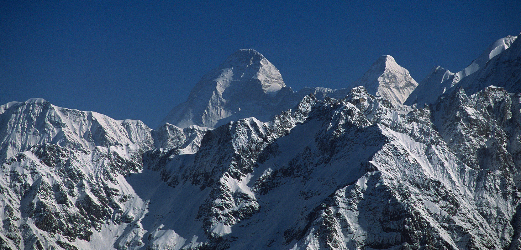 The summits of Nanda Devi (7816m) and Nanda Devi East (7434m) from near Kalgudi Bhel KhalNikon F90X, 180mm, Fuji Velvia