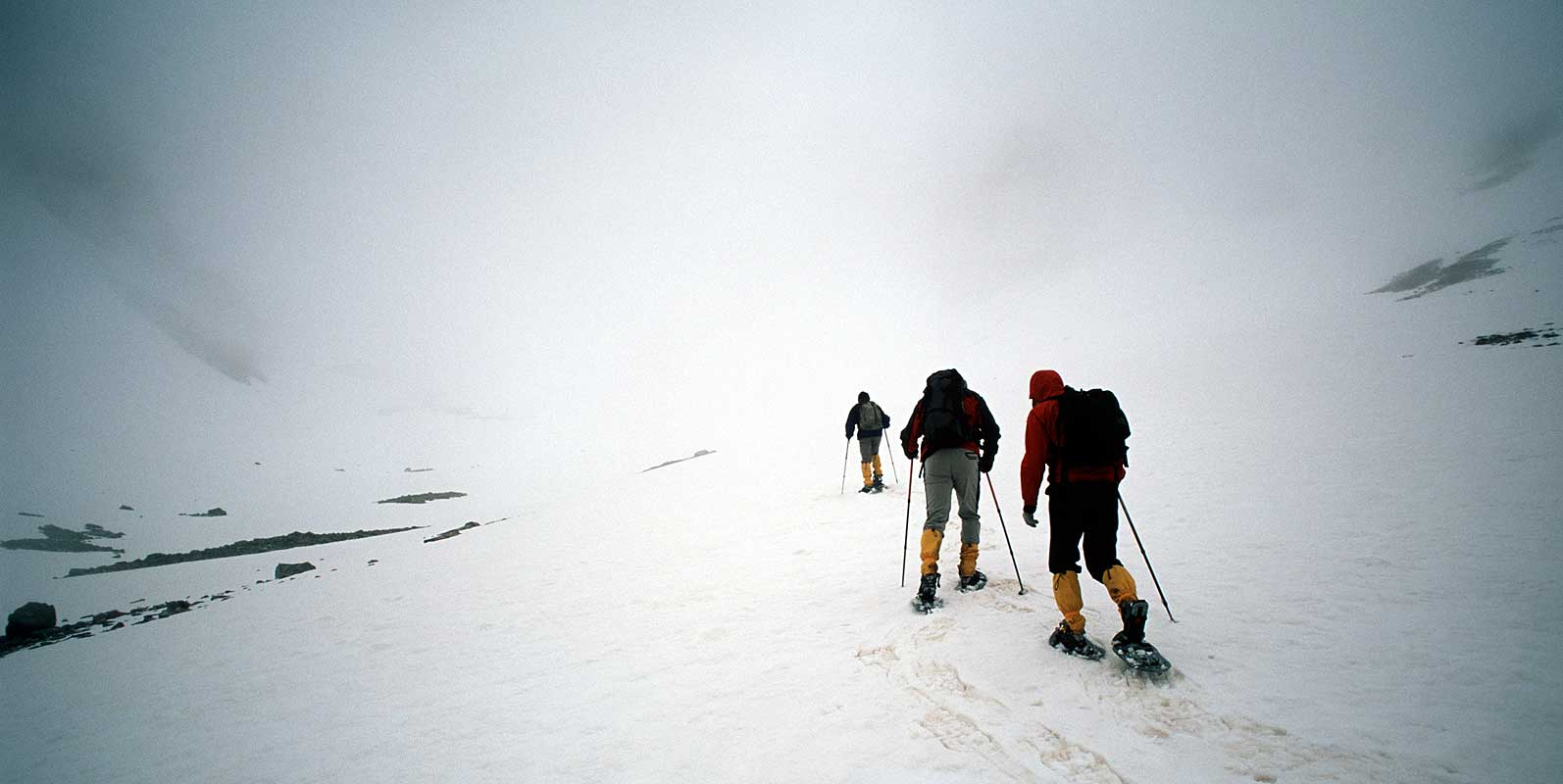 Heading up to the col and into a white-out