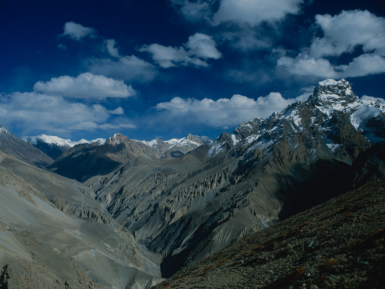 The Pamir-i-Tang is the name given to the upper Shimshal river, and it is through this difficult valley that most of the village and all their livestock migrate every spring to the summer pastures at Shujerab and Shuwert. On the right is the mountain massif of Chot Pert.