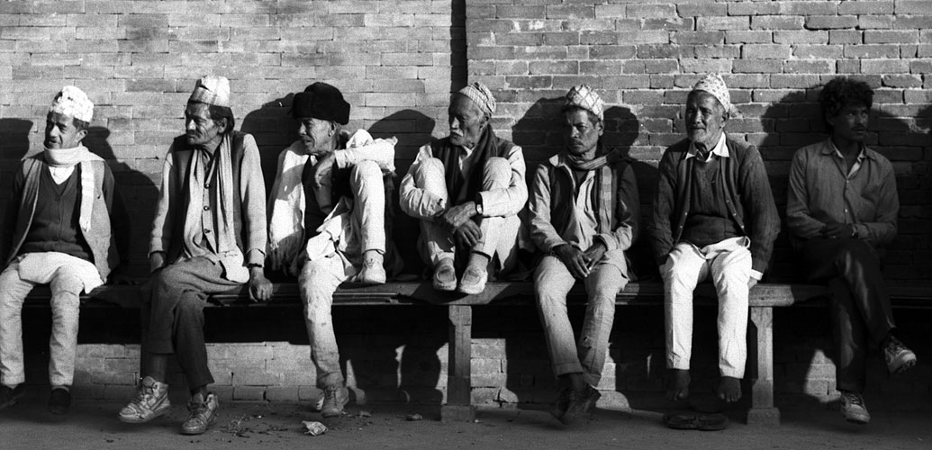 A group of men soaking up the warm winter sun in Durbar Square, PatanBronica ETRS, 75mm, FP4