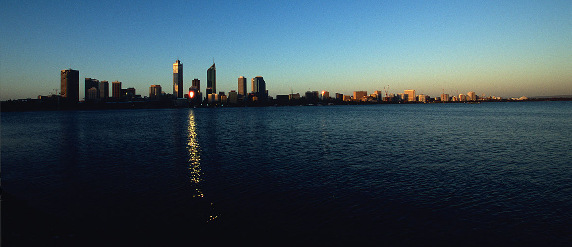The city, seen at sunset across the Swan River from South PerthNikon F5, 17-35mm, Fuji Velvia