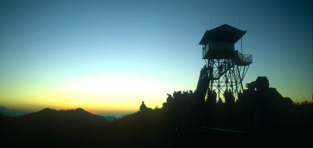 Anyone hoping for a peaceful sunrise experience at Poon Hill will be disappointed. Hundreds of people get up every morning before dawn and form a torchlit procession up to this spectacular viewpoint. This is the new viewing platform at the top.Nikon FM2, 24mm, Fuji Velvia