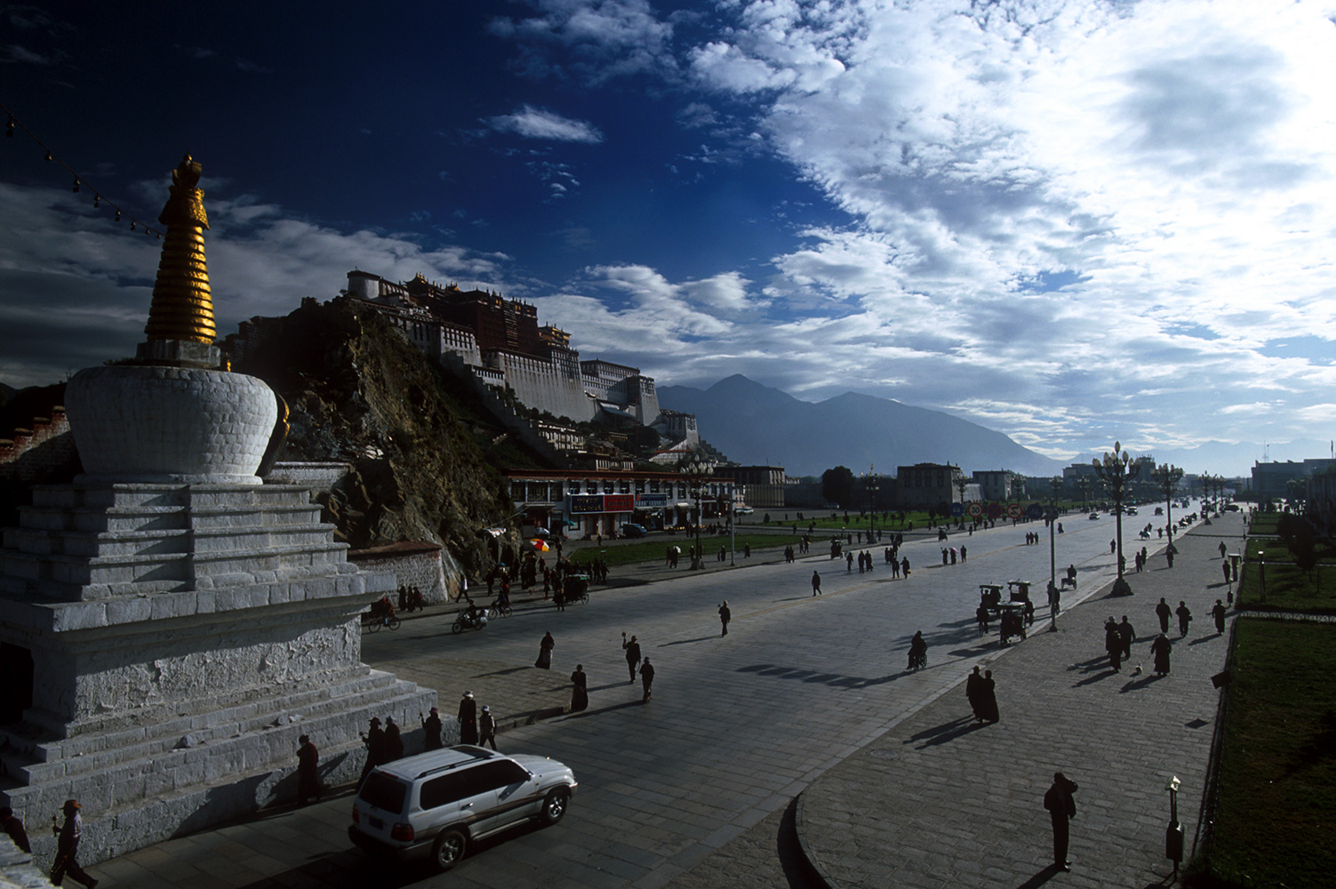 The Potala, seen from the base of Chokpuri Hill. The old West Gate to the city was here, demolished long ago by the Chinese to make way for the modern road.Nikon F5, 17mm, Fuji Velvia