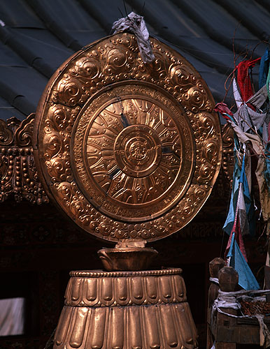 A magnificent darma wheel (one of the eight sacred elements of Buddhism) on the roof of the Potala in LhasaBronica ETRSi, 50mm, Fuji Velvia