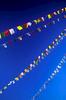 Against an azure sky, prayer flags flutter in the breeze at BodnathNikon FM2, 50mm, Fuji Velvia