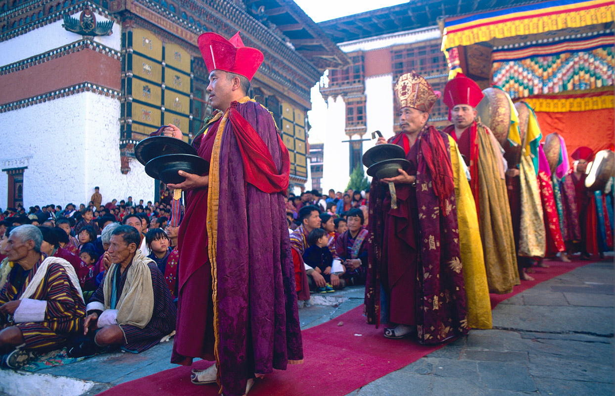 Monks entering the courtyard to perform during the annual tsechu Nikon FM2, 24mm, Fuji Velvia