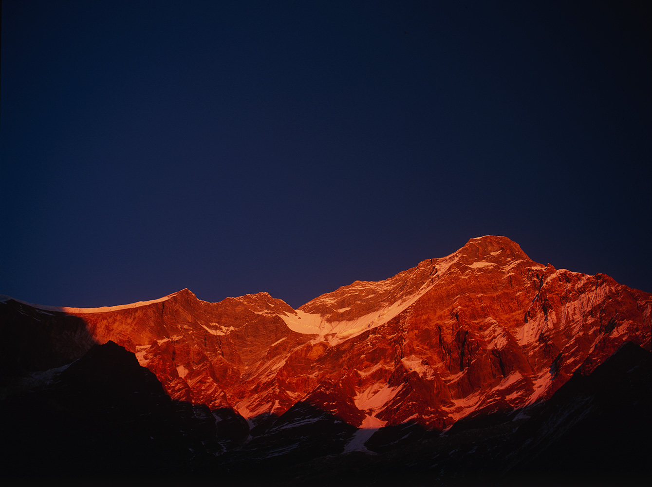 Arguably the highest mountain precipice on earth, this stupendous west face rises vertically for over 4000m from the meadows below.  This shot taken at sunset in mid December.Project VeronicaMedium format images re-scanned in a professional glass film- holder with my Nikon Coolscan 9000 and Silverfast 8 software. These images display larger on the site - enjoy!Bronica ETRSi, 50mm, Fuji RVP