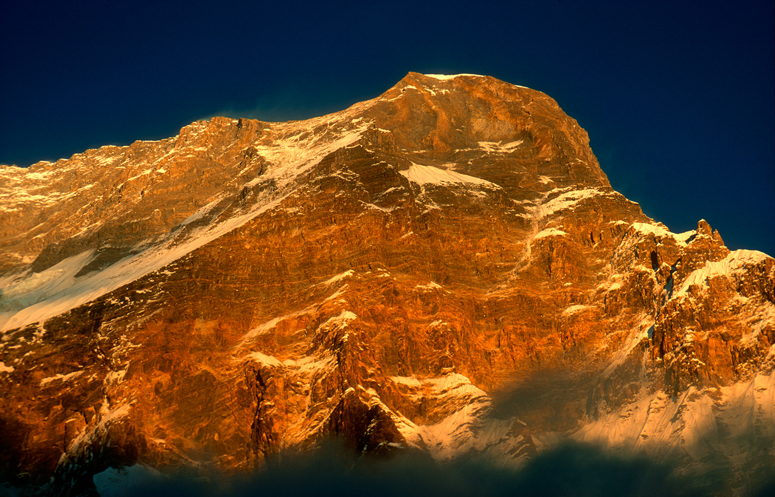 Otherwise known as the Puchhar Wall, this is one of the greatest precipices on earth. Puchhar, or Italian Base Camp, is at an altitude of 3500m. The summit of Dhaulagiri I is almost 5000m  - three vertical miles - immediately above.Nikon FM2, 105mm, Fuji Velvia