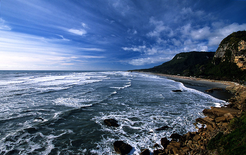 The relentless surf of the Tasman Sea pounding the west coast of New Zeaalnd's South Island. Looking north from the famous Pancake Rocks.Nikon F5, 17-35mm, Fuji Velvia