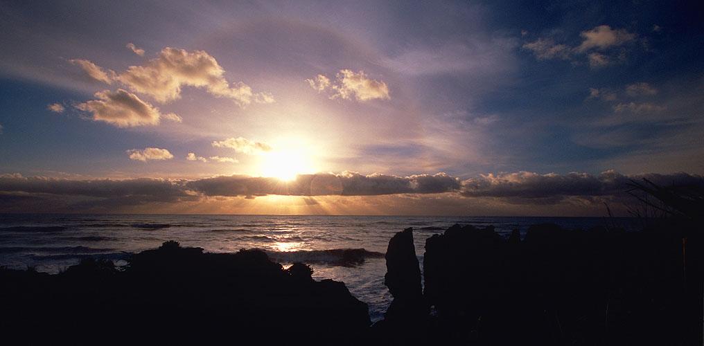 The famous Pancake Rocks silhouetted against the setting sunNikon F5, 17-35mm, Fuji Velvia