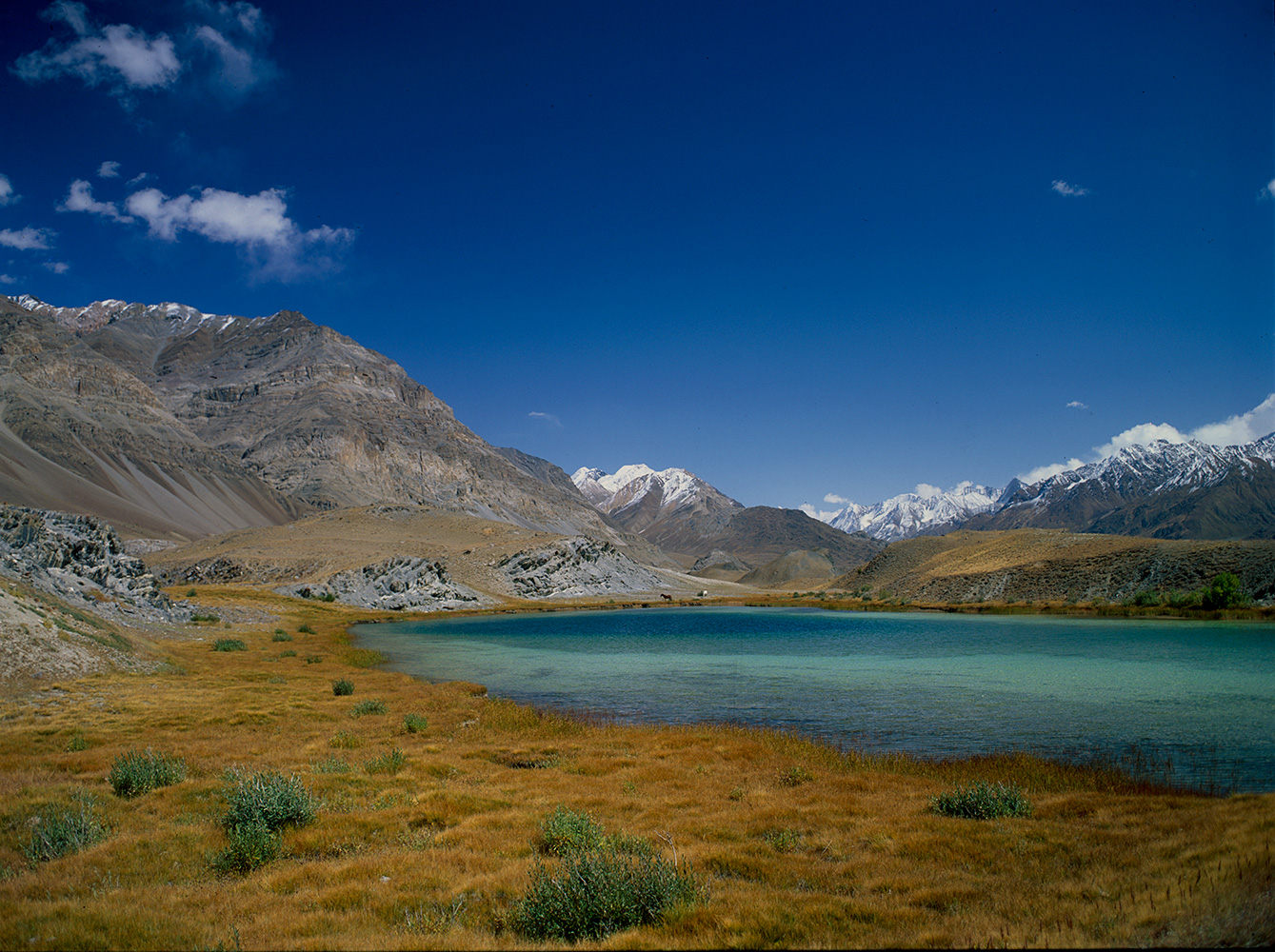 This lake lies just below Qui Quldi on the approach from Ishkarwarz. Beyond is the snout of the Chiantar glacier.Bronica ETRSi, Fuji Velvia