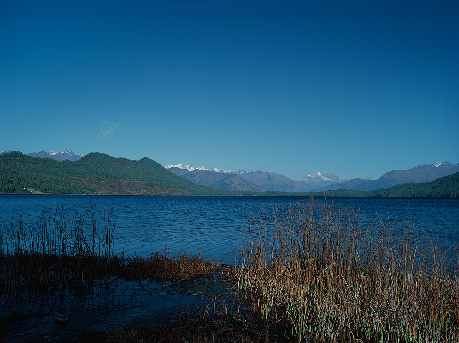 A view east across the lake from the western shore, looking towards the mountains of MuguProject VeronicaMedium format images re-scanned in a professional glass film- holder with my Nikon Coolscan 9000 and Silverfast 8 software. These images display larger on the site - enjoy!Bronica ETRSi, 50mm, Fuji Velvia
